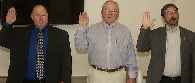 From left, David Simmons, Steve Bauer and Tony Brown are sworn in Monday at Baldwin City Council members. All three men won four-year terms on the council in last month's general election.