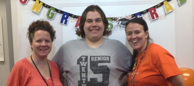 Steven Shonkwiler (center) poses with special education staff members Julie Deason (left) and Tierney Thompson Monday at Bonner Springs High School. His mother, Monica Shonkwiler, praised the staff members who have helped Steven, who has autism, throughout his education.