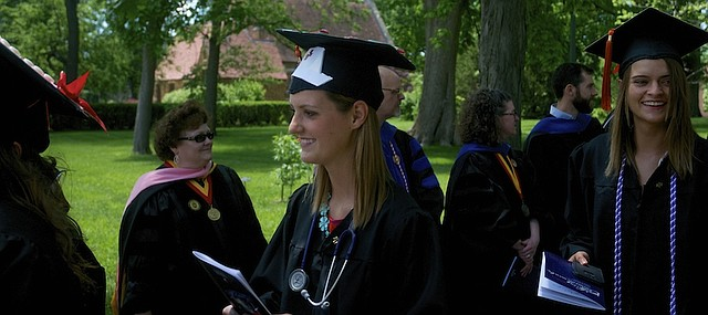 Baker University School of Nursing graduate Shelby M. Riley accessorizes appropriately for the school's Class of 2015 commencement. Riley and the other about 300 students in the class ended the traditional march across campus by walking between rows of the school's faculty before taking their seats for the commencement.
