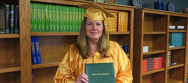 Joan'll Montague, who works for USD 458's food service department, decided to take advantage of the district's virtual school to complete her high school diploma and was part of this year's graduating class.