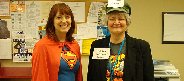 Bonner Springs City Library's Lesley Lard, youth and teen librarian (left), and Jank Rink, children's coordinator, dressed as SuperReader and Lois Jane to promote the Summer Reading Program at USD 204 elementary schools earlier this month.