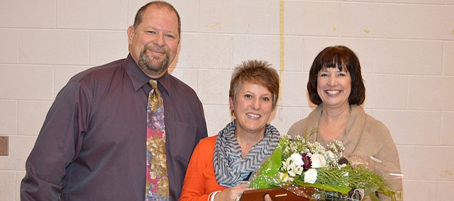 Bonner Springs Elementary Principal Kim Mitchell (center) poses with Jeff White, National Association of Elementary School Principals representative (left), and Cindy Heibert, Kansas Association of Elementary School Principals District 1 Governor, following a special ceremony honoring her selection as Kansas Principal of the Year.