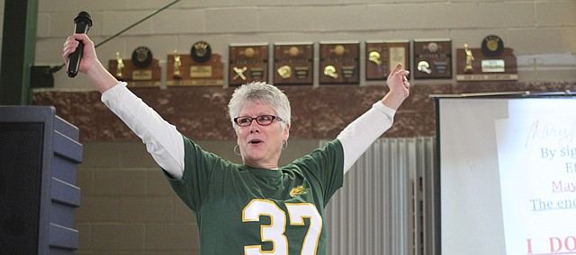 "Mary Myer announced her retirement in February on National Signing Day by signing a ""letter of intent"" to leave Basehor-Linwood High School after 35 years."