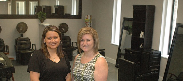 Jessica Sanchez (left) and Kelly Cummins recently reopened Savvy Hair Studio on Kaw Drive after a fire destroyed the original Front Street location five months ago.