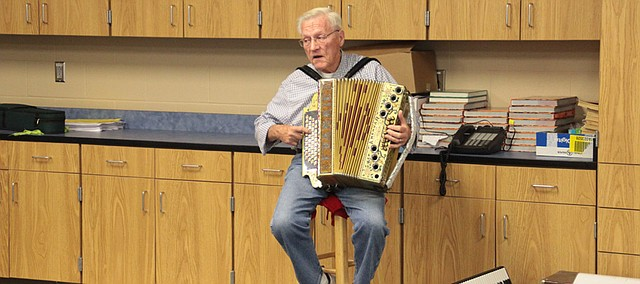 Frank Palcher of Basehor plays his antique accordion from the early 1900s for Basehor Intermediate School students on May 6.