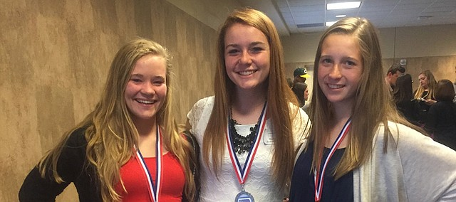 Claire Walsh, Madison Bowers and Calder Hollond (from left) pose after competing at the National History Day state competition, where they earned first place and the right to compete next week at the national competition in Washington, D.C.