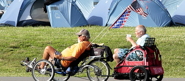 A scene such as this Biking Across Kansas camp in Eudora from 2009 will be played out Friday at Baldwin Junior High School as the tour spends its last night in our community. The 880 bikers will be entertained downtown at Joe Spurgeon Park.