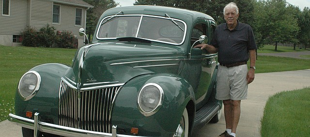 Earl Lohuis of Basehor stand with his 1939 Ford Deluxe Sedan.
