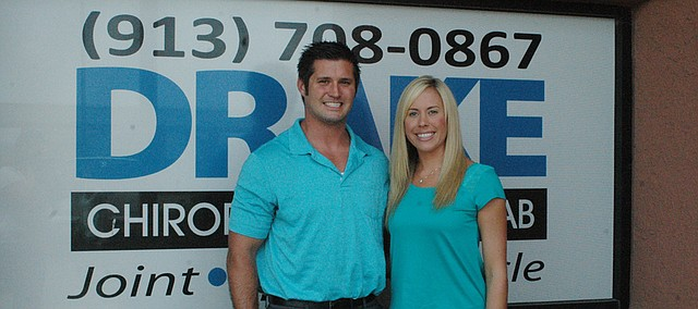 Chiropractors Matthew Drake (left) and Sarah Froehlich are celebrating their practice's expansion and selection as the Basehor Chamber of Commerce's Business of the Month for July.