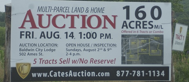 A sign on the fence of the farm of the late Margaret Counts advertises an auction that could have big consequences for Baldwin City's future. The farm just east of the Signal Ridge subdivision will be sold Aug. 14 through a multi-parcel auction.