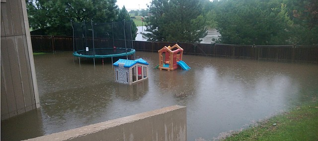 Josh Sudduth took this photo of the flash floodwaters in his Basehor back yard July 6 just as they began to recede.