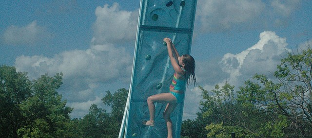 Alexis Moeschler makes her way up the new climbing wall at Bonner Springs Aquatic Center.