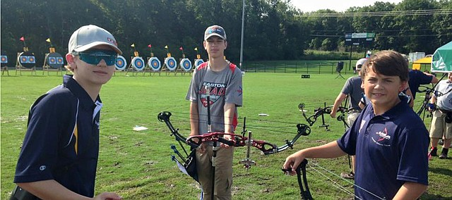 Kolton Heidebrecht of Bonner Springs, center, competes with two other shooters during the team event at the Easton Junior Olympic Archery Development Nationals competition July 1-5 in Alabama. Heidebrecht and his parents, Joanna and Kerry Heidebrecht, have founded the Prairie Fire Archers club, which will have its KC Summer Sizzle tournament Aug. 8 and also will start offering beginner and intermediate archery classes in August.