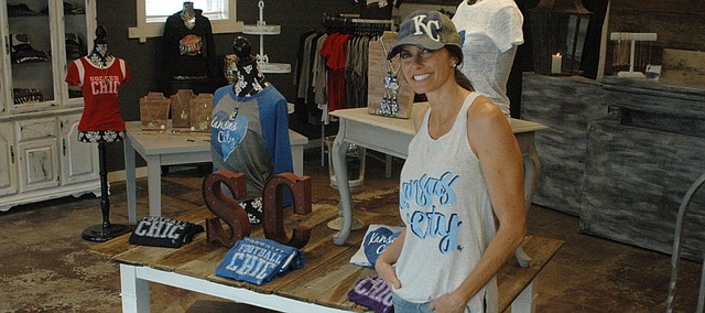 Danni Boatwright, co-owner of Sideline Chic, has moved her women's sports fan apparel business to a new home in Downtown Bonner Springs.