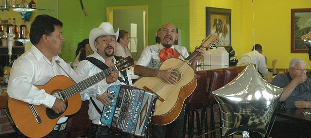 A mariachi band performs for a packed house Friday at the grand opening of Rodeo Mexican Restaurant in Basehor. The restaurant, which first opened in late May, has been working to overcome the bad reputation of its predecessor, with a focus on good service and fresh food.