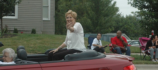 Judy Miksch waves from the Grand Marshal vehicle in Saturday's Tiblow Days parade. Miksch was the recipient of this year's Marion Vaughn Community Service Award.