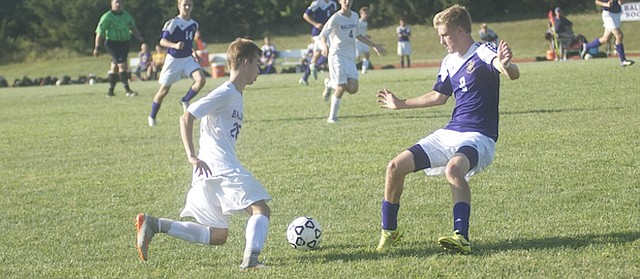 Baldwin sophomore Blayne Champman, looks for an opening in the Spring Hill defense ;ast Thursday in the Bulldogs' 2-1 loss. The team lost 5-1 to De Soto Tuesday  and will play Basehor-Linwood at home Thursday.