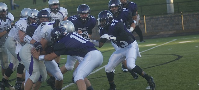 Baldwin running back Joel Katzer bulls ahead for yardage in the Bulldogs 27-26 victory Friday at Piper. The senior ran for two touchdowns and his twin brother Jake Katzer added to more as the Bulldogs won their second thriller of the young season.
