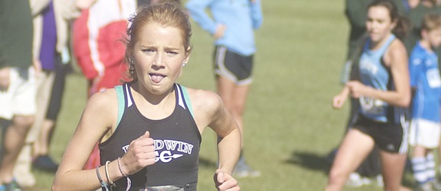 Baldwin senior Addie Dick churns up a hill Saturday on her way to a fourth-place finish at the Baldwin Invitational. With five runners in the top-20, the Bulldog girls finished second at the event.