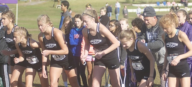 Baldwin cross country coach Mike Spielman gives last-second instructions to his varsity girls as they prepare for the start of Saturday's 5K at the Maple Leaf Classic at Baldwin City Municipal Golf Course. The girls, from left Hollie Hutton, Natalie Beiter, Fayth Peterson, Mackenzie Russell, Daelyn Anderson and Addie Dick, finished third in the 10-team event.