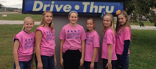 Contributed photo Tonganoxie Elementary School fifth-grader Corinne Morgan, third from left, stands with friends at Sonic. Corinne and her friends will be serving as car hops Friday to help raise money for diabetes research. Corinne's Crew then will participate in a walk Saturday at the Truman Sports Complex in Kansas City, Mo. Pictured, from left, are Taylor Rantz, Jenna Witt, Corinne, Ally Rawlings, Katelyn Bothwell and Alaina Rogers.