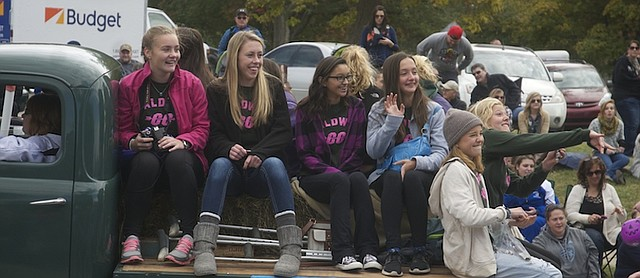 Members of the Baldwin High School girls cross country team ride in Saturday's Maple Leaf Festival Parade two days after they and they and the boys team won Frontier League championships. The teams will compete Saturday in the 4A regional at Baldwin City Municipal Golf Course.