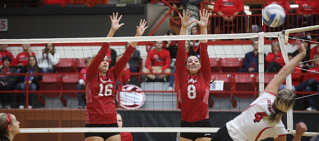 Tonganoxie High's Cheyenne Ford (16) and Nicole Tallent (8) jump up to block a hit from McPherson's Megan Pedersen. McPherson defeated Tonganoxie in pool play Friday, Oct. 30, 2015, in the Salina Bicentennial Center at the Class 4A Division I state volleyball tournament. THS and McPherson both advanced to Saturday's semifinals.
