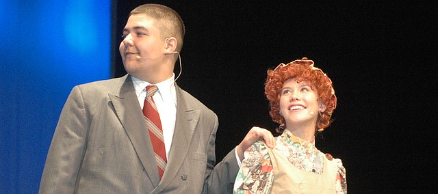 "Juan Vela-Oreaz, playing Daddy Warbucks (left), and Heidi Rodgers, playing Annie, are among the 90 percent of the cast of ""Annie"" at Bonner Springs High School who have never been in a theater production before."