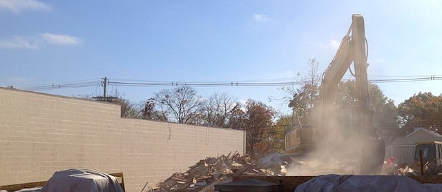 Workers raze two building last week in the 700 block of High Street.