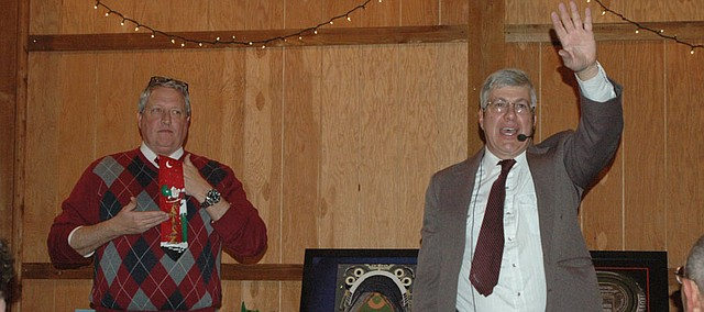 Mayor Jeff Harrington, left, models the infamous tacky Christmas tie during the 2013 auction benefiting Vaughn-Trent at the Bonner Springs Rotary Club's Annual Holiday Banquet. This year's event, returning after a temporary absence last year, is set for Dec. 3.