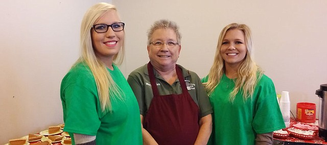Brittany and Erin Laney, members of the Basehor Rustlers 4-H group, have been volunteering at the annual Thanksgiving dinner at the VFW since they were in the 4th grade. They are pictured here with their grandmother, Mary Ellen Ballard (center), who also volunteered at the dinner.