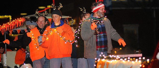 Baker University students enjoy a ride on a float during a recent Festival of Lights Parade.