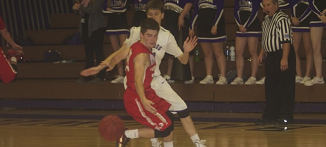 Tonganoxie Tyler Novotney goes behind his back to shake a Baldwin defender in Thursday's opening-season contest for both team. Baldwin won the game, 60-50.