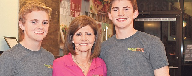 Missy Andersen, middle, is pictured with sons Austin Andersen, left, and Andrew Andersen, both of whom help their parents out at their new business, Tropical Smoothie Cafe. Missy is co-owner with her husband, Scott Andersen.