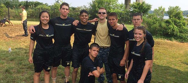 Madison Wheat, far right, stands with a group last summer at the United States Naval Academy Summer Seminar, a fast-paced, six-day experience for high achievers who have completed their junior year in high school.