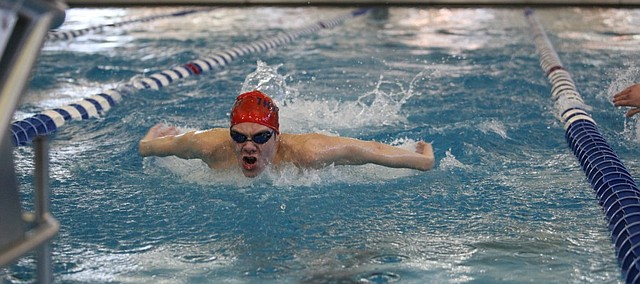 St. James junior Andy Maginn finishes up the butterfly in the 200-yard individual medley on Friday at the Class 5-1A preliminaries in Topeka. Maginn won the IM and took third in the 100-yard backstroke to qualify for the championship heat Saturday.