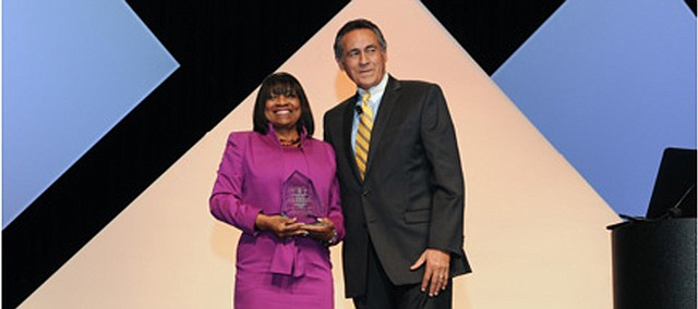 Elizabeth Sanders accepts the Effie H. Jones Humanitarian Award, presented by the American Association of School Administrators, earlier this month at the AASA's national conference in Phoenix.