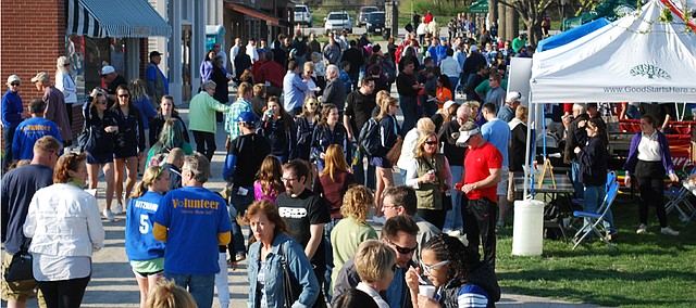 The crowd meanders through the grounds of Shawnee Town last year for the inaugural Taste of Shawnee event, organized by the Shawnee Rotary Club. The first event attracted an estimated 1,500 visitors. This year's event is set for April 16.