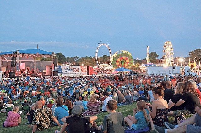 A crowd of onlookers sat and listened to the music being performed on the main stage Friday night of the Old Shawnee Days festival.