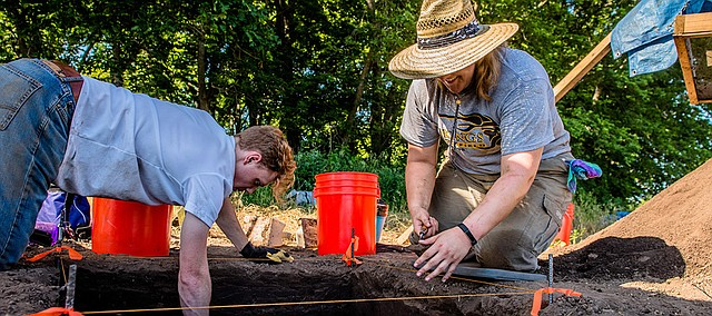Chase Oswald (left) of Shawnee and another student work at a dig site for the Kansas Archaeological Field School, run by Kansas State University.