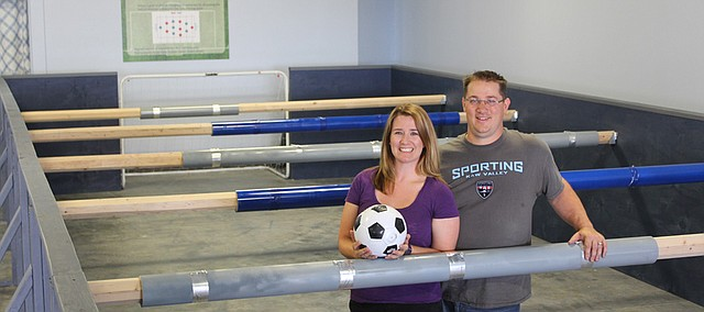 Brittany and Lucas McWilliams of Tonganoxie opened Kick It Foos in western Shawnee in June, providing family-friendly and team-building games like Human Foosball.