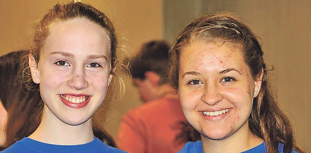 Shawnee teens Anna Clements, left, and Jesse Gunkel are members of Summit Bible Quizzing, an area church-based group. Their Bible quizzing team, Moxie, in April placed second at the national tournament in Colorado.