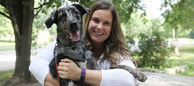 Jamie Shockley sits with her dog, Bernie, an Australian shepherd/chocolate Labrador mix. Bernie won The Mirror/Leavenworth County Humane Society's Cutest Pet Contest after Bernie received the most votes in July during the Facebook contest.