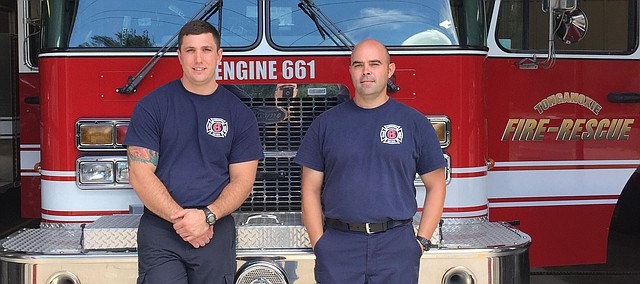 Contributed photo Tonganoxie firefighters, from left James Davis and Capt. Adam Griffith stand with their fire truck. The two delivered a baby Saturday at a Tonganoxie residence.