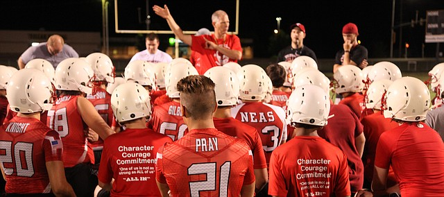 Tonganoxie High football coach Al Troyer chats with his team after the first practice of the season Monday, Aug. 15, 2016, at Beatty Field. THS opens the season Sept. 2 against Spring Hill at home.