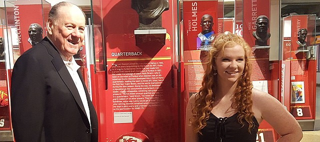 McKinna Shelton, at right, stands with Pro Football Hall-of-Famer and former Kansas City Chief quarterback Len Dawson. Shelton won this year's Len Dawson Scholarship.