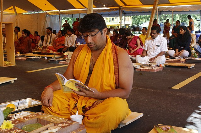 Ravi Aysola, of Overland Park, reads from a prayer book at the Hindu temple in Shawnee.