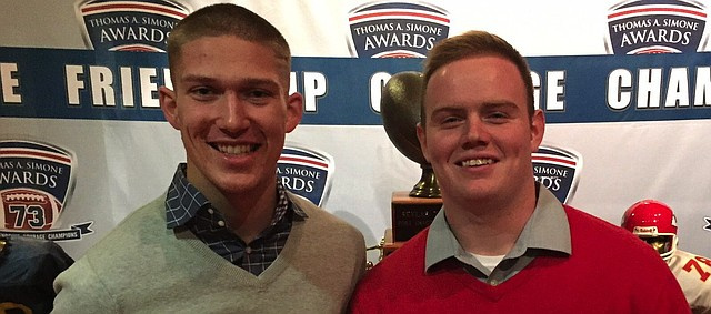 Shawnee Mission North seniors Will Schneider, left, and Danny Presler, right, pose for a photo after the 2016 Simone Finalist Show Monday at Arrowhead Stadium. Schneider is one of four finalists for the award, which goes to the most outstanding player in the Kansas City metro area. The SM North quarterback was joined by Presler, Mill Valley safety Joel Donn and St. James Academy defensive end Travis Pickert.