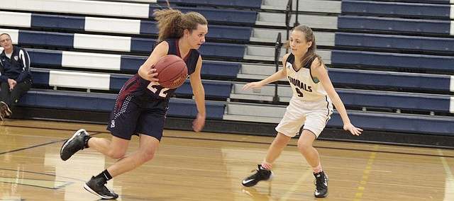 St. James Academy junior Mary Goetz drives past Eudora freshman Riley Hiebert during the Thunder's 47-33 win Monday over the Cardinals.