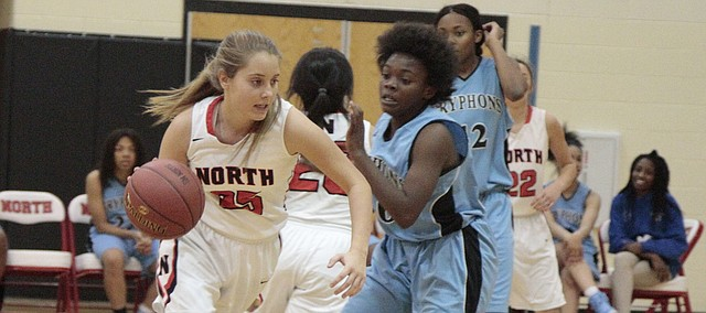 Shawnee Mission North junior Mackenzie Vielhauer drives to the basket during the Indians' 57-15 win over University Academy Charter on Thursday. Vielhauer scored nine points.